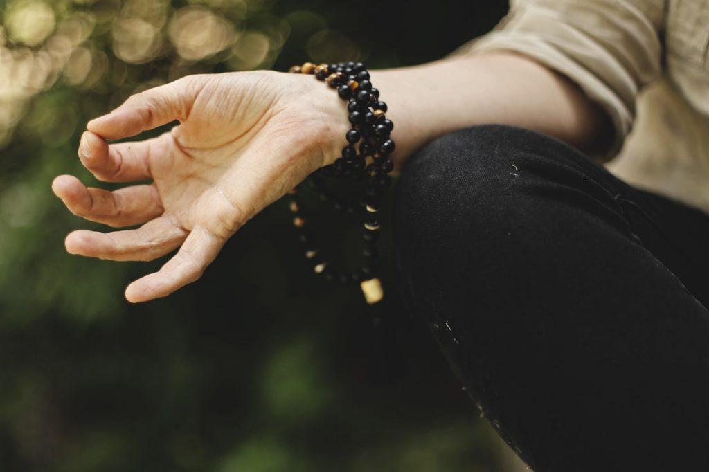Meditating outdoor in Vipassana meditation technique