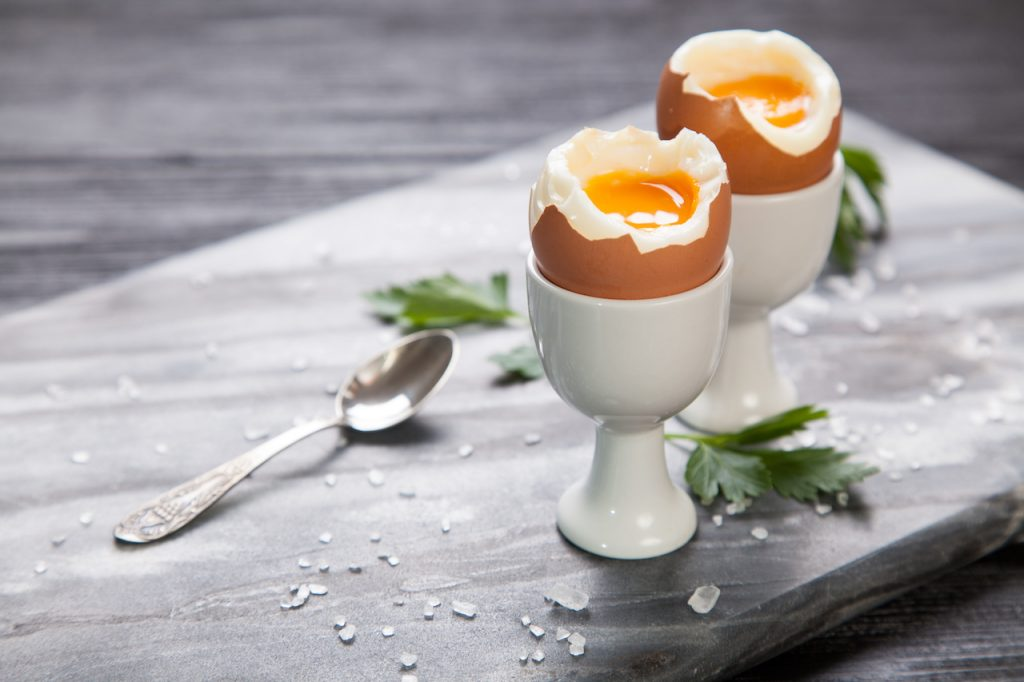 Soft boiled eggs on a marble top