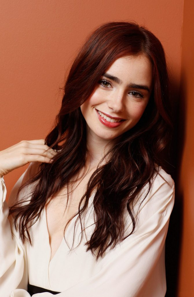 Lily Collins smiling