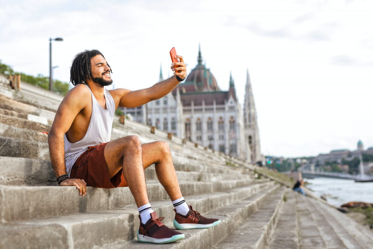 smiling man taking a selfie for his bumble dating site profile