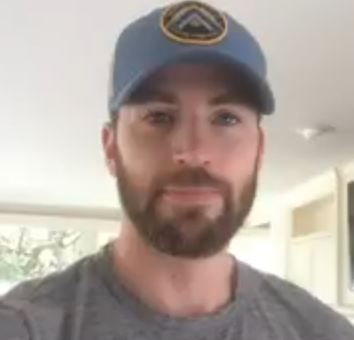 chris evans wearing a cap and grey shirt