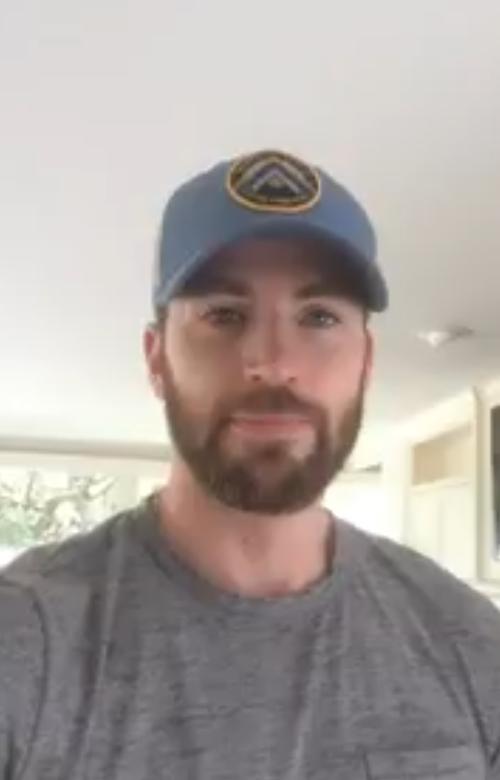 chris evans wearing a cap and grey shirt
