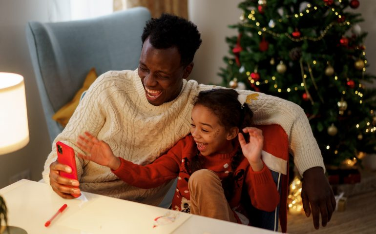 father and daughter laughing at christmas memes
