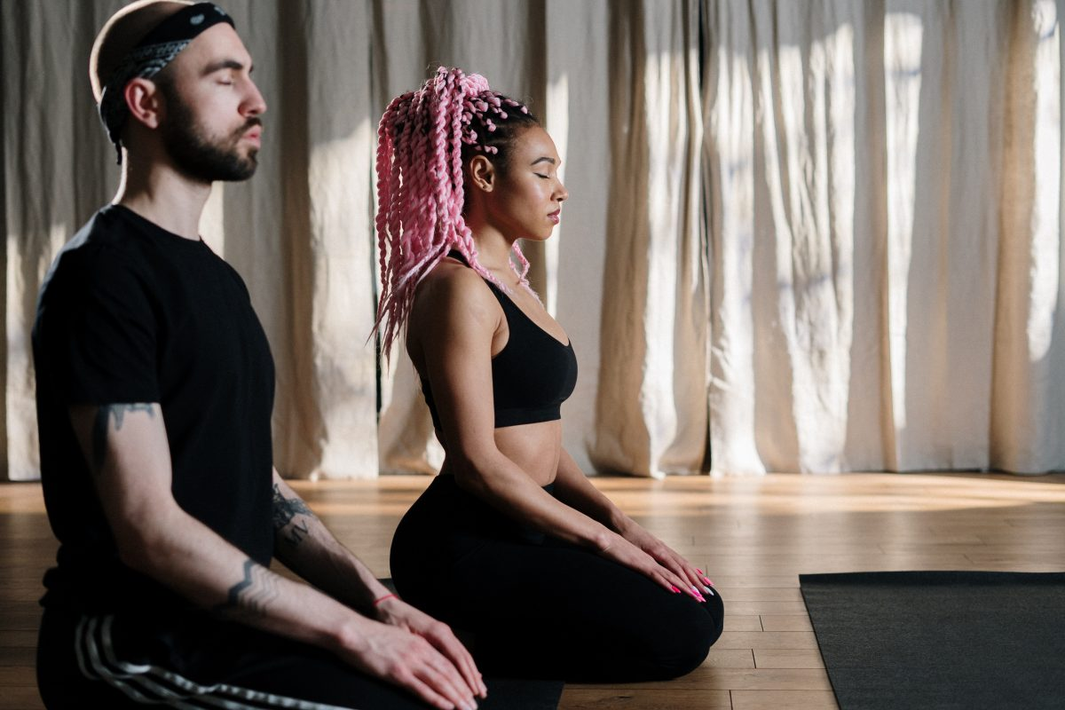 man and woman listening to meditation music