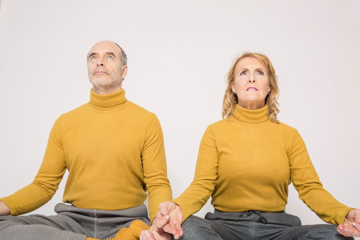 old couple meditating