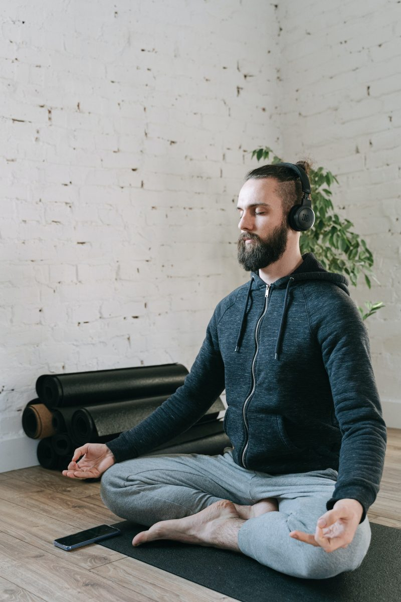 man listening to meditation music on headphones