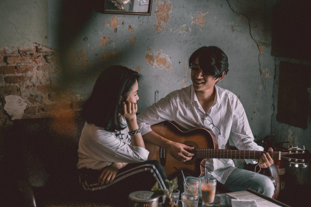 man serenading a woman